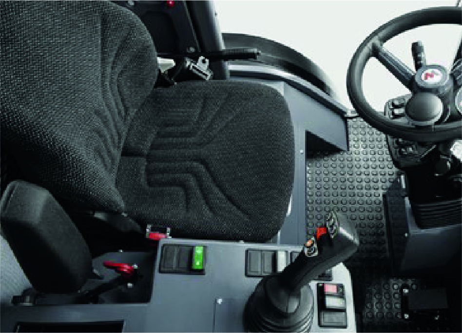 cabine intérieure chargeuse pneus